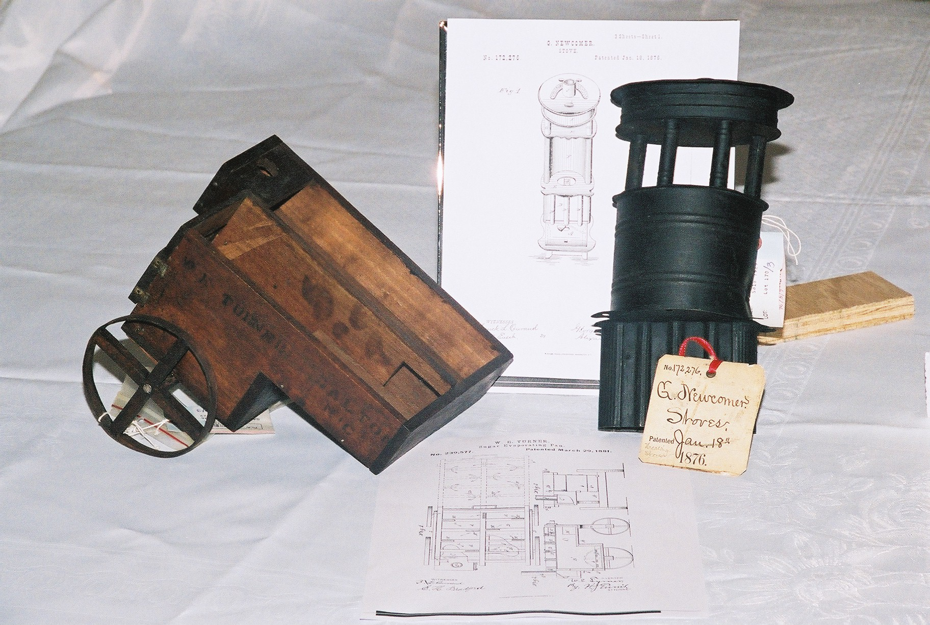 Photo of actual patent models of a sugar evaporator (left) and a stove.  Click anywhere on photo to return!